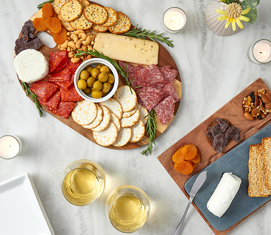 Charcuterie board with food and drinks