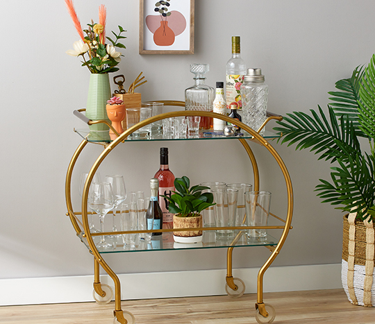 Bar cart with glassware and décor
