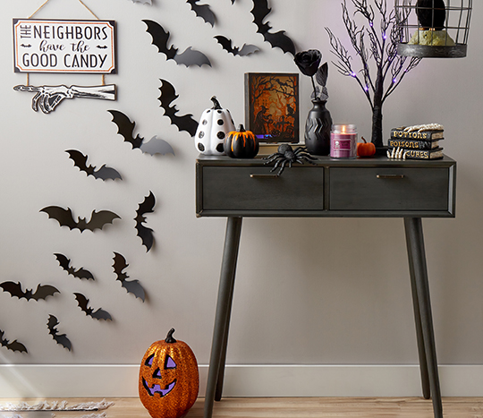 Entryway table decorated with halloween décor