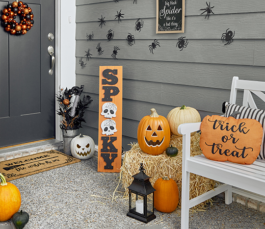 front door halloween décor with bench and pumpkins