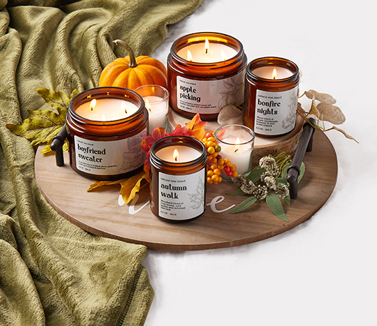 fall scented candles displayed on a tray with decorative accents