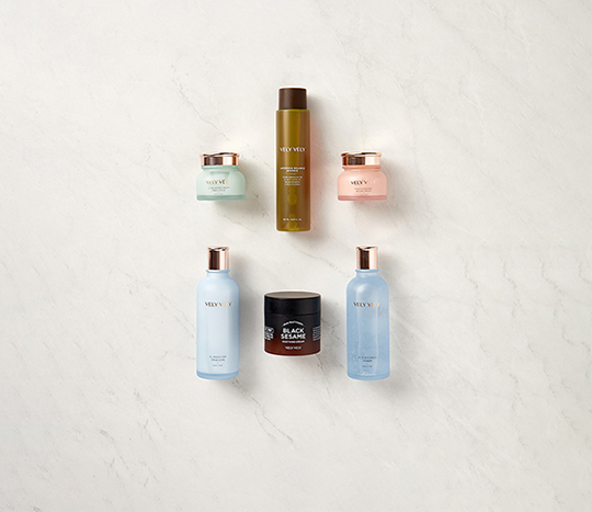 six beauty and skincare items displayed on a flat surface